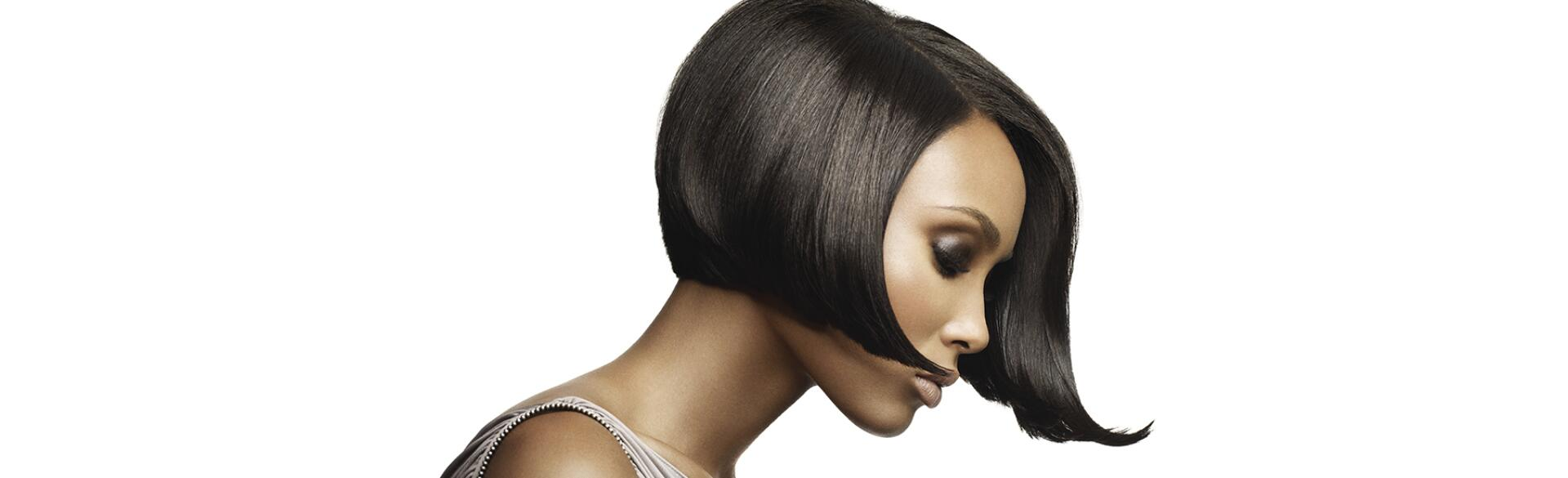 beautiful black woman seen from the side wearing a short-bobbed wig
