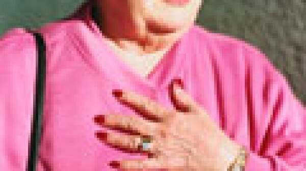 Hooked on Heartburn Medication- woman holding her chest in discomfort