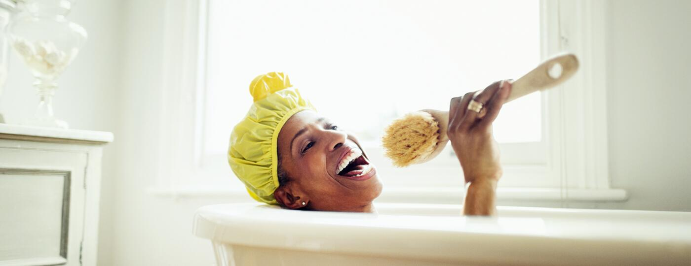 image_of_black_woman_in_bathub_with_shower_cap_GettyImages-639546321_1540.jpg