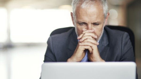 Man looking intently at laptop