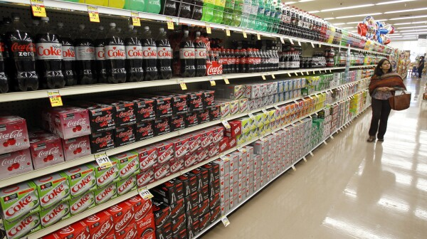 A shopper walks by the sodas aisle at a grocery store in Los Angeles