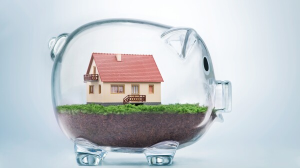 Saving to buy a house or home savings concept