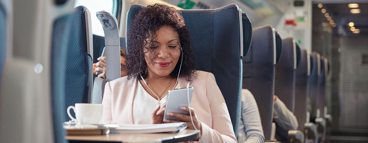 image_of_black_woman_on_train_using_phone_GettyImages-939658760_1540.jpg