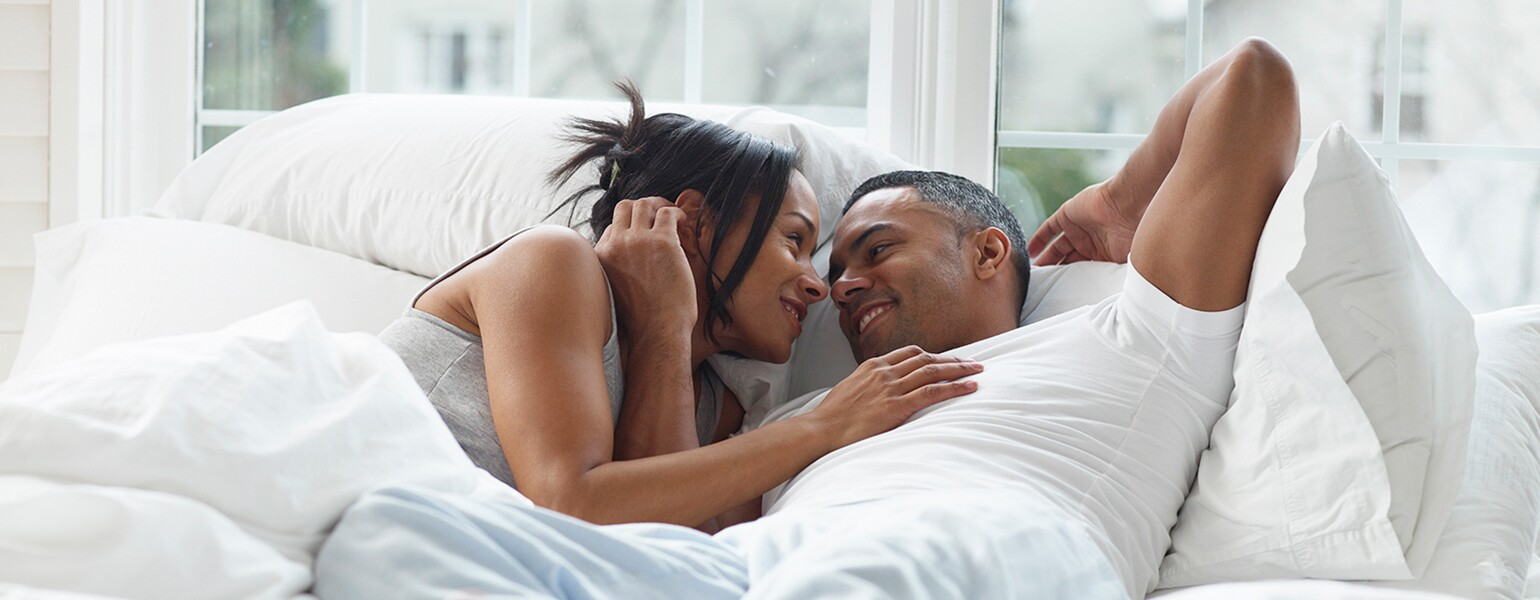 image of couple in bed