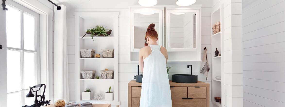 woman washing face while smiling
