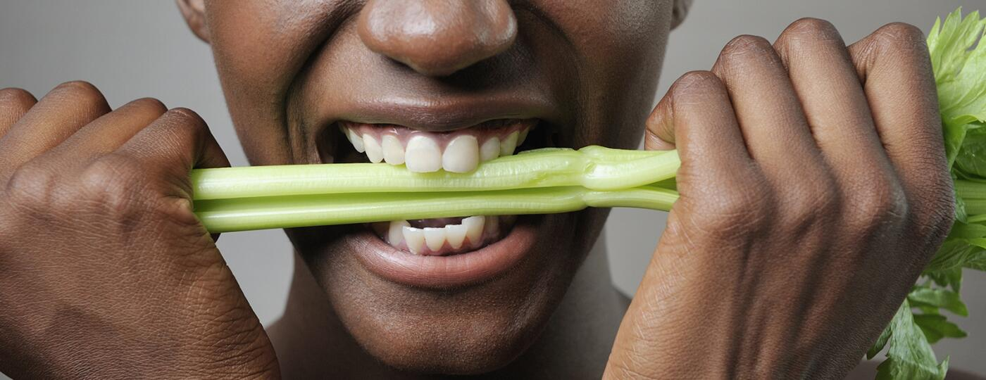 image_of_woman_holding_and_biting_down_on_celery_stalk_GettyImages-112507347_1800