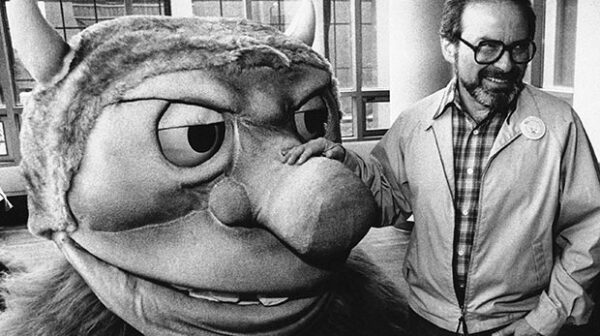 Maurice Sendak poses with one of the characters from his book Where the Wild Things Are.