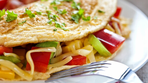A close-up view of an omelette on a plate