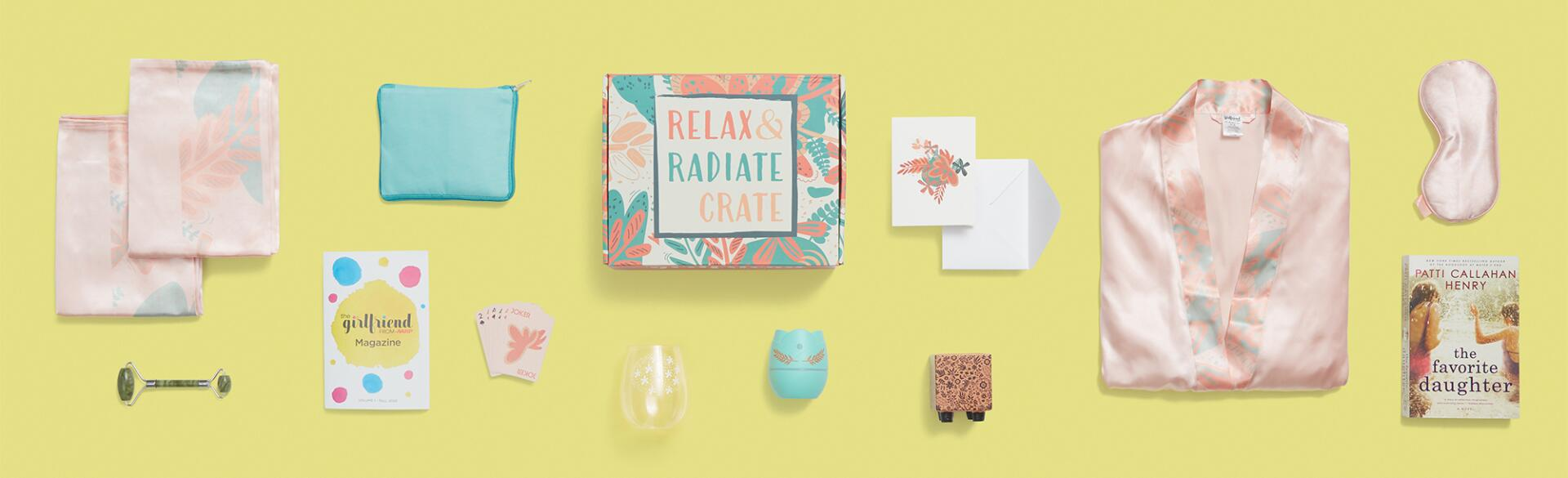 Fall 2020 Relax and Radiate crate contents photographed from above on a yellow background