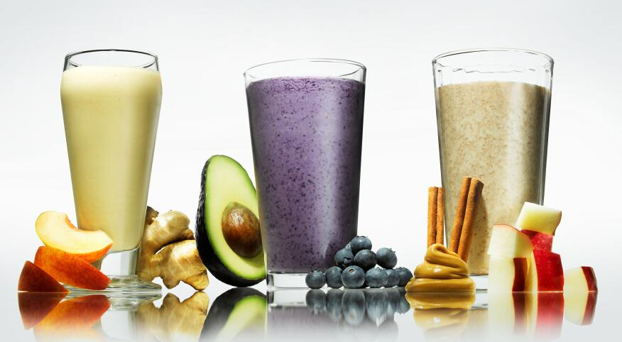 three smoothies with some ingredients around them