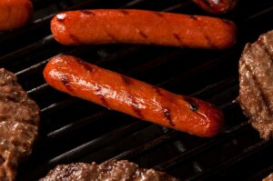Hamburgers and hot dogs on a grill