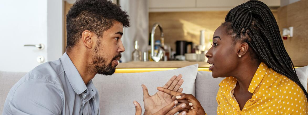 Black woman and man quarreling at home