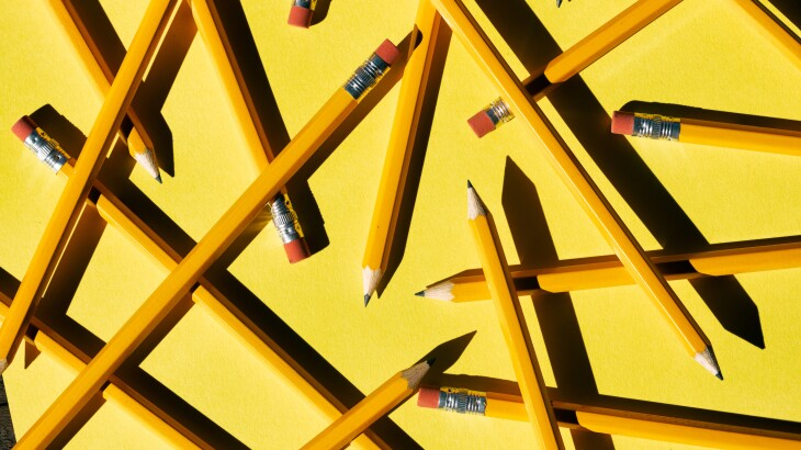 Layers Of Pencils Scattered On yellow Paper
