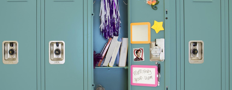 An image of an open high school locker.