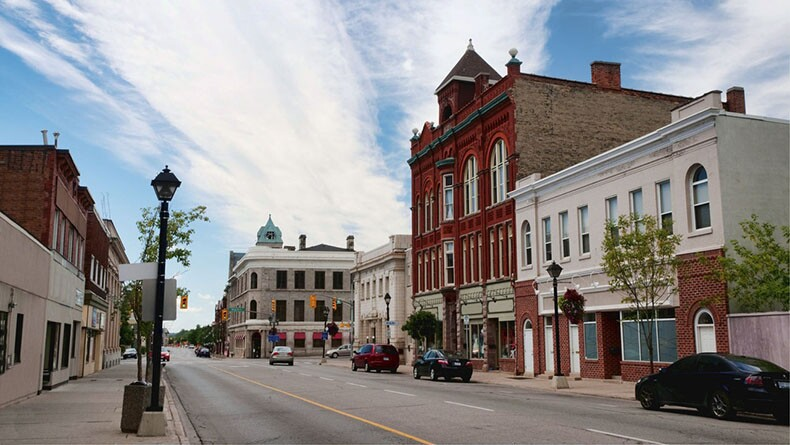 A street with buildings lining either side in Madison, Wisconsin,