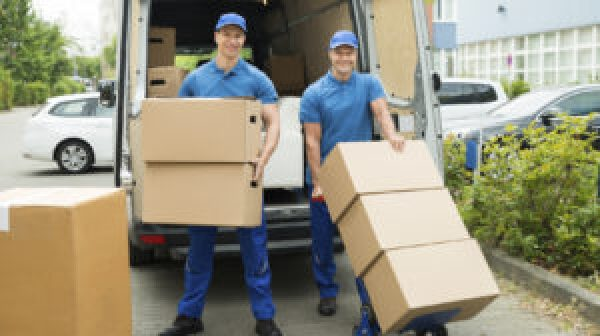 Two movers loading boxes into a truck