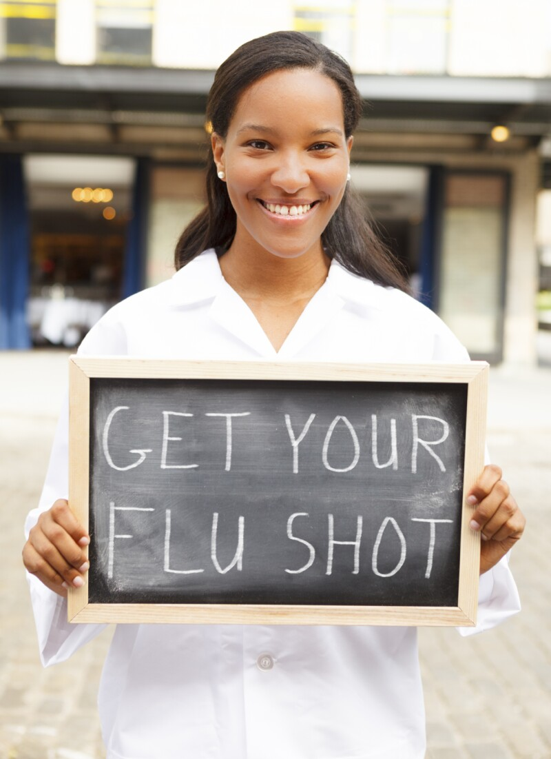 Young Woman with Flu Shot Sign