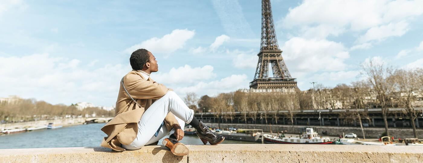 image_of_woman_sitting_gazing_at_Eiffel_tower_GettyImages-1057205524_1800