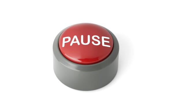 Red Circular Push Button Labeled 'Pause' on White Background