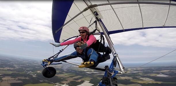 Author Heather Sweeney Skydiving, in a helicopter and paragliding