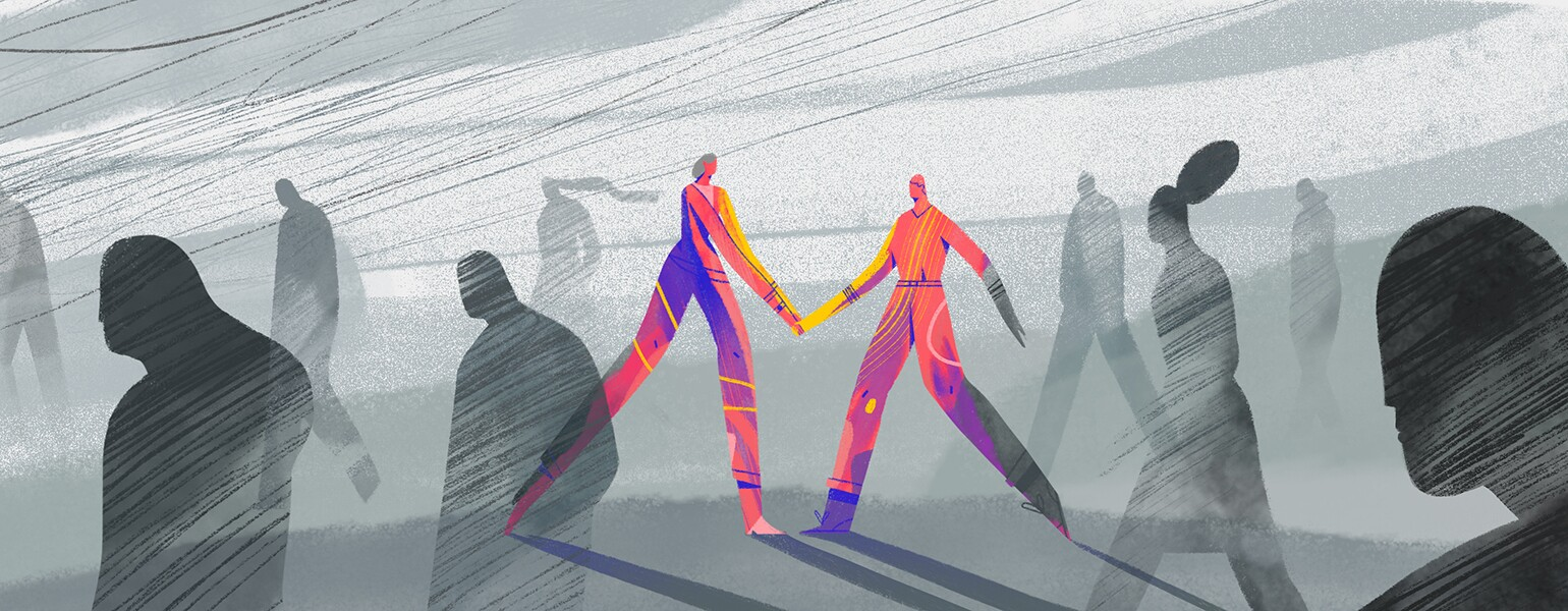 A graphic of two people holding hands together.