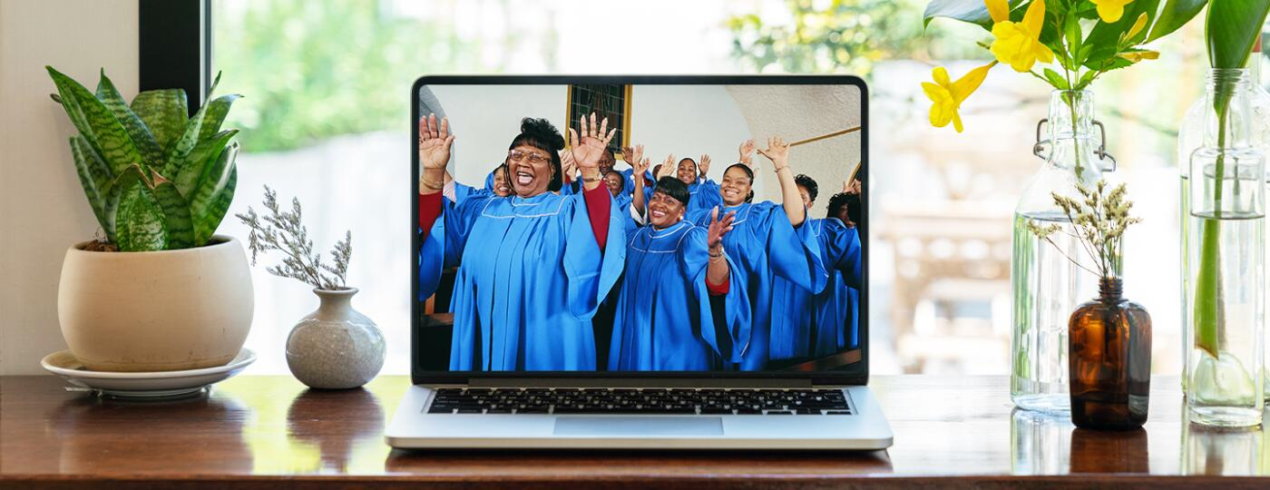 photo_of_laptop_on_desk_streaming_Easter_Service_sisters_1440x560.jpg