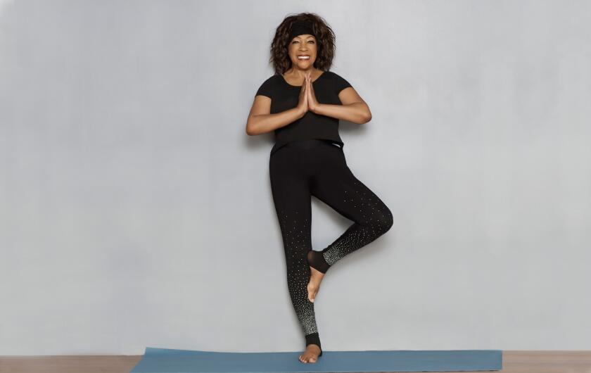 Mary Wilson doing yoga