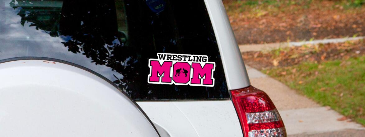 Car with bumper sticker that says wrestling mom