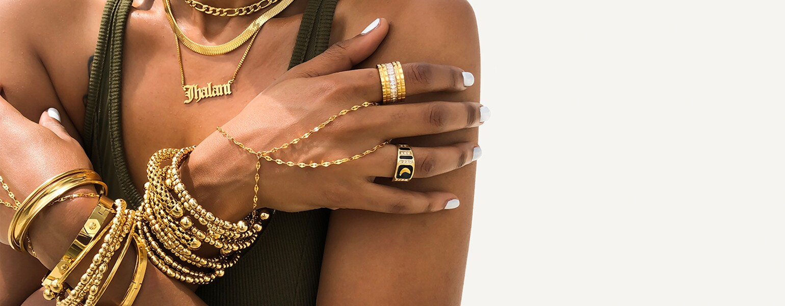 image of black woman layers of gold jewelry