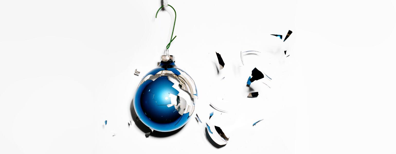 A smashed blue bulb Christmas ornament.