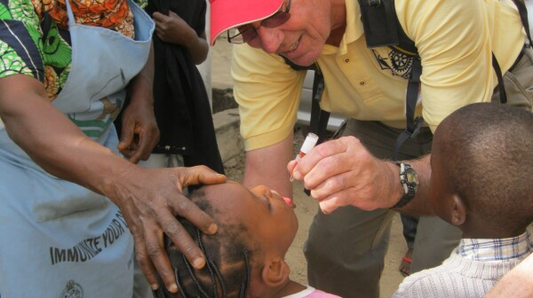 Ken Hughes volunteer giving vaccine
