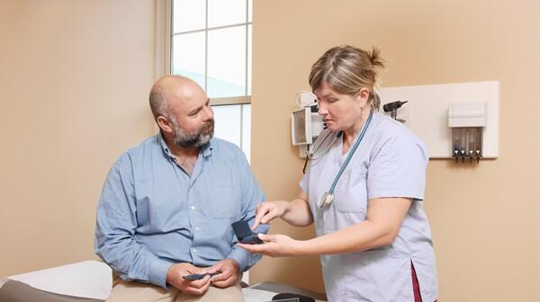 nurse-explaining-diabetic-equipment-to-patient