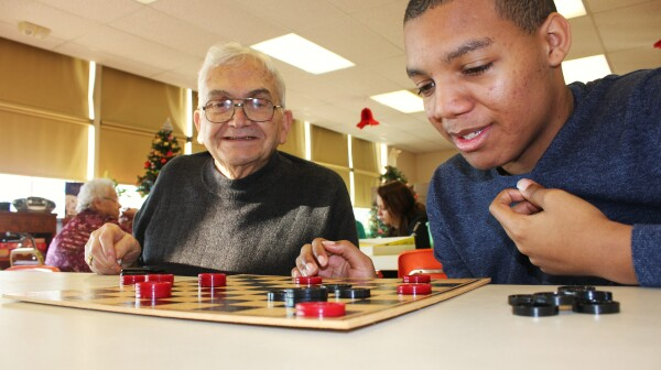 Sage Ted and Seeker Kyree play each other in a game of checkers during the Sages & Seekers program in Spring Grove, PA.