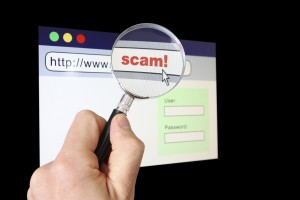 """Magnifying glass over browser revealing the URL is a """"scam"""""""
