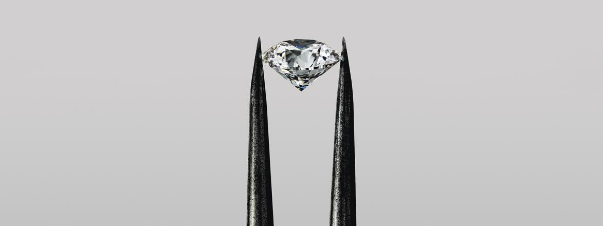 Diamond in tweezers on grey background