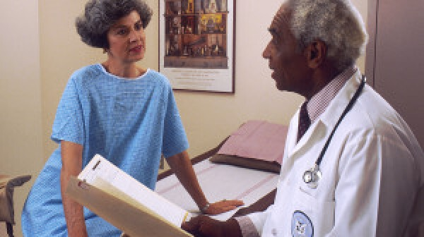 Doctor consults with female patient