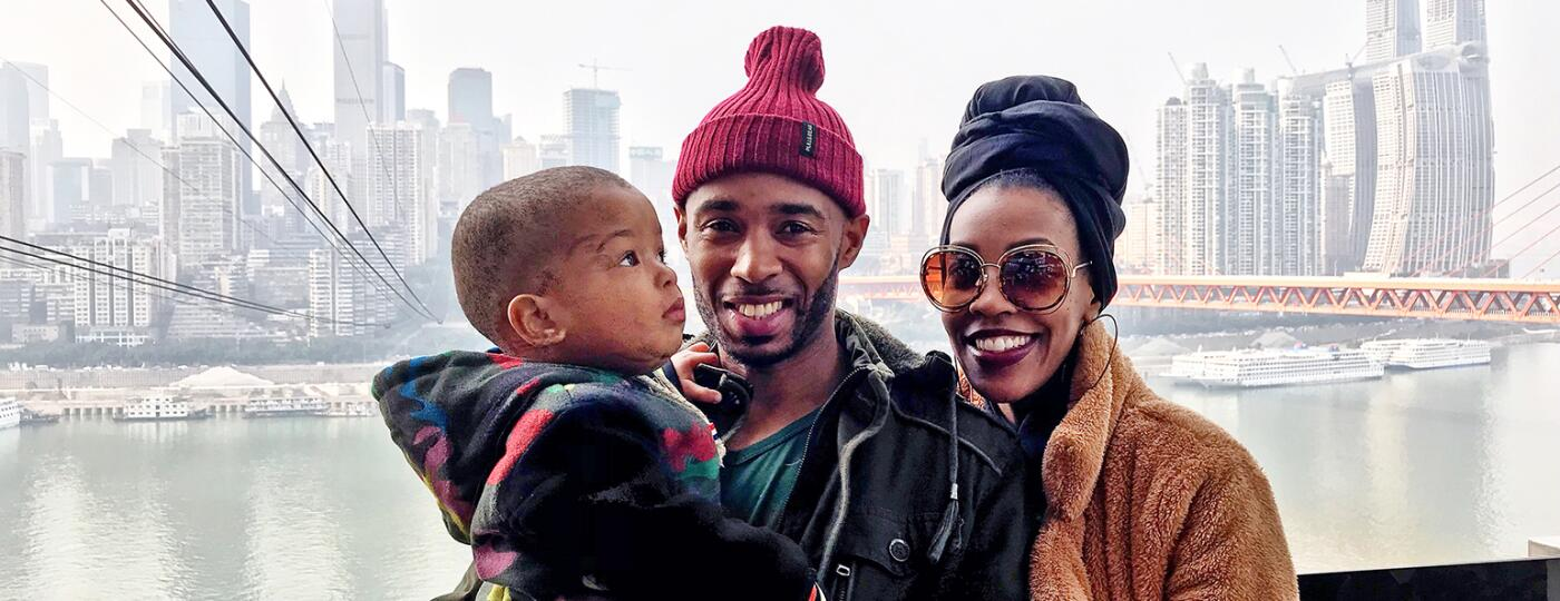 Photo of black family living in a different country