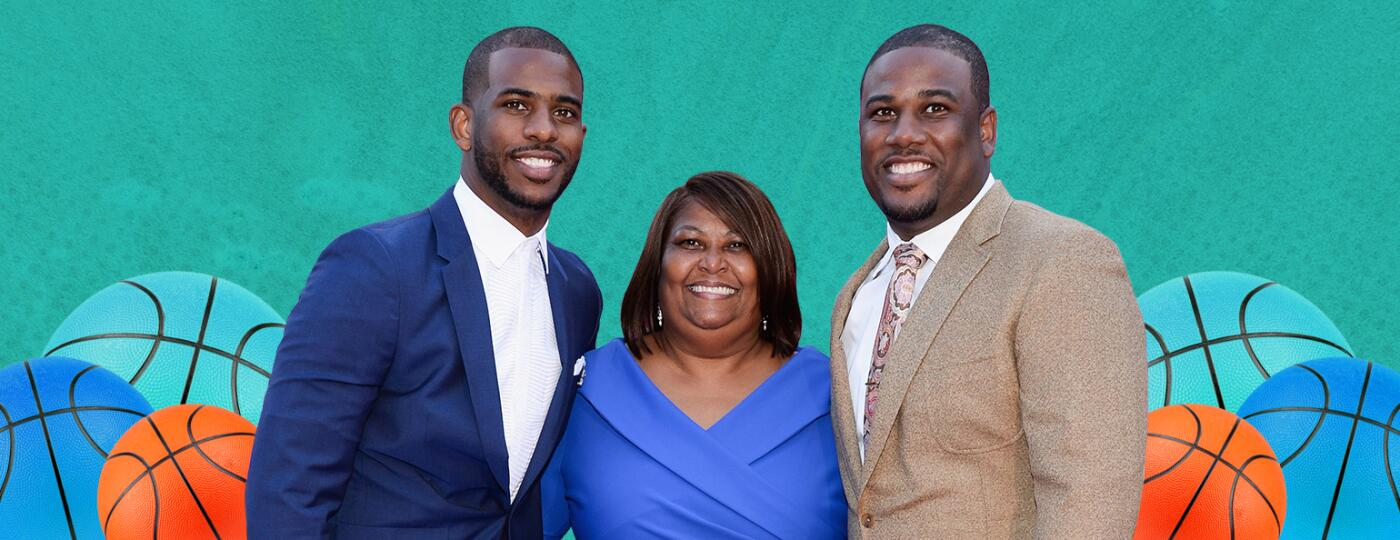 A mother stands in-between her two successful sons.