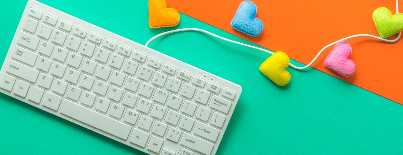 Directly Above Shot Of Computer Keyboard With Colorful Heart Shapes Over Colored Background