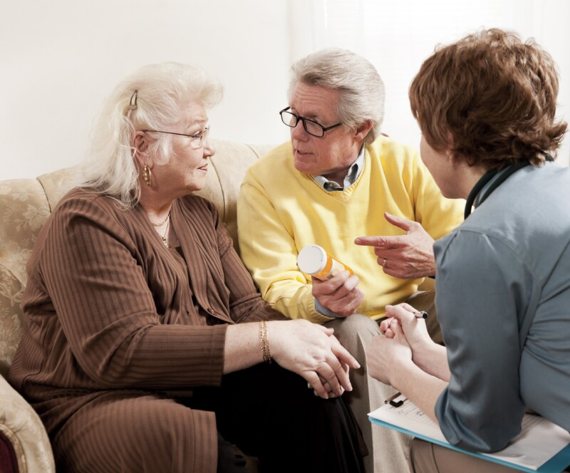 Doctor Discussing Medication with Senior Couple