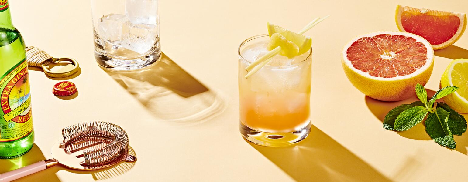 mocktail surround by grapefruit and mixer