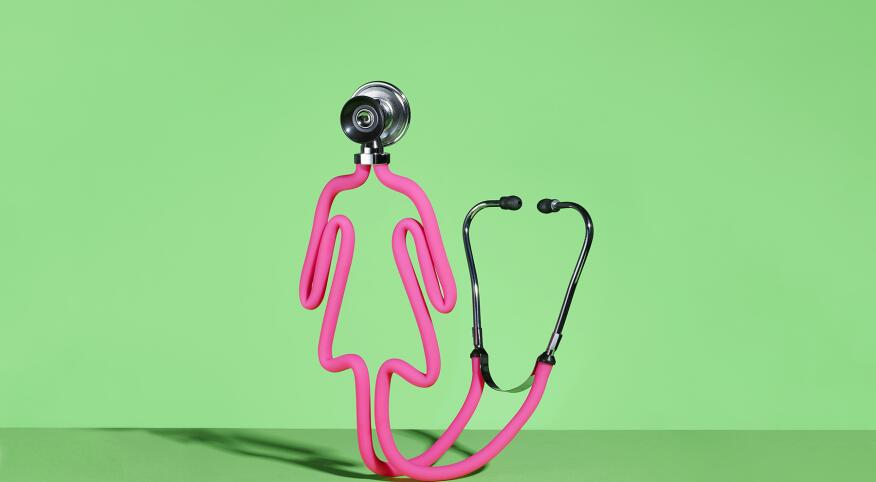 a pink stethoscope in the shape of a female on a green background