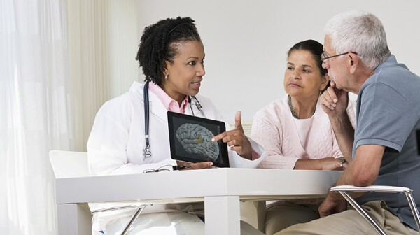 A female doctor showing a brain scan to a patient