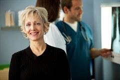 240-woman-doctors-office-new-pap-test-advice