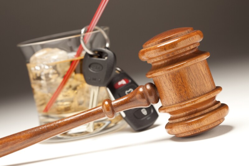Gavel, Alcoholic Drink & Car Keys on a Gradating to White Background - Drinking and Driving Concept.