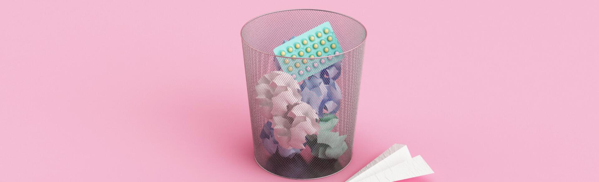 garbage can with birth control pill package in it