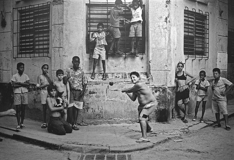 Boys playing stickball