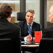 Financial adviser with clients