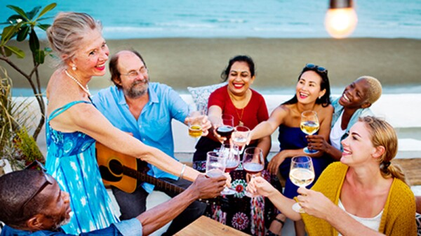 A group of people drinking together on the beach