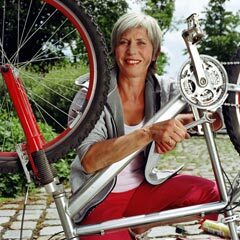 240-woman-fixing-bike-infuriating-fibs-women-over-50
